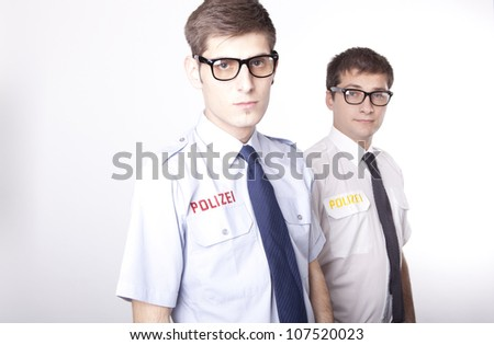 Young German policemen with glasses. - stock photo
