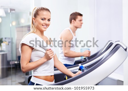 Young girl and a man in the gym - stock photo