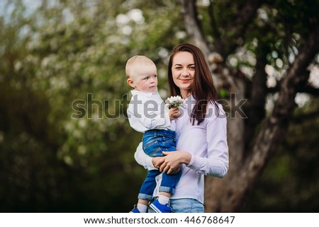 Young girl and baby boy - stock photo