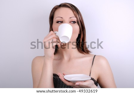 Young girl and cup of coffee - stock photo