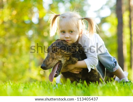 Young girl and dog - stock photo