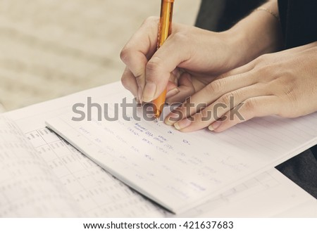 Young girl and education, closeup of hands of student doing exercise for universitet exam. - stock photo