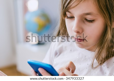 Young girl and using smartphone - stock photo