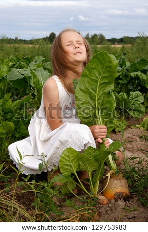 Young girl at country plants - stock photo