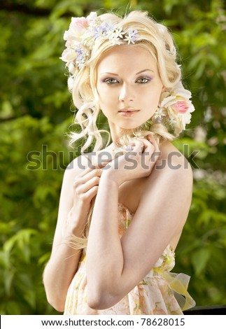Young girl blonde and flowers in her hair - stock photo