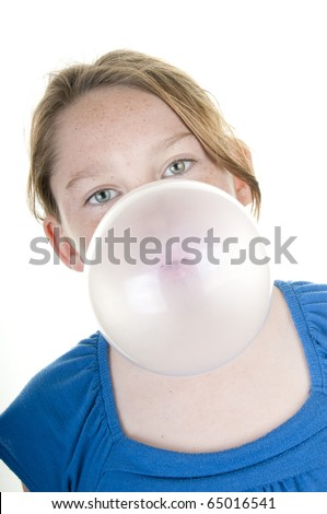 Young girl blowing huge gum bubble - stock photo