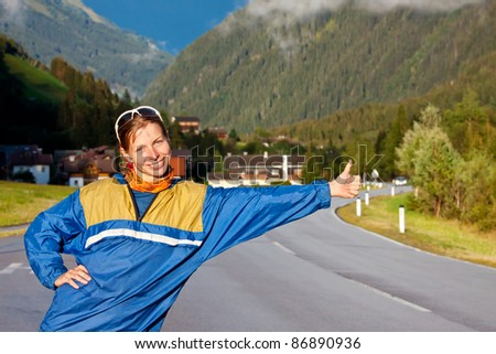 Young girl catching a car - stock photo