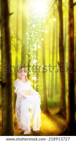 young girl catching falling stars - stock photo