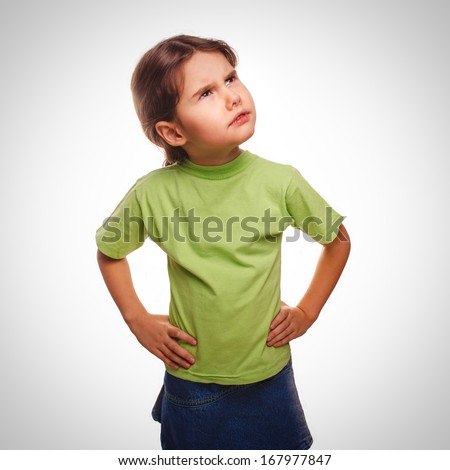 young girl child teenager idea thinks looking up isolated on white background gray - stock photo
