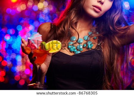Young girl clubbing at nightclub - stock photo