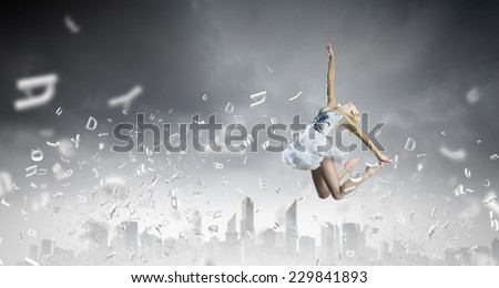 Young girl dancer jumping high in sky - stock photo