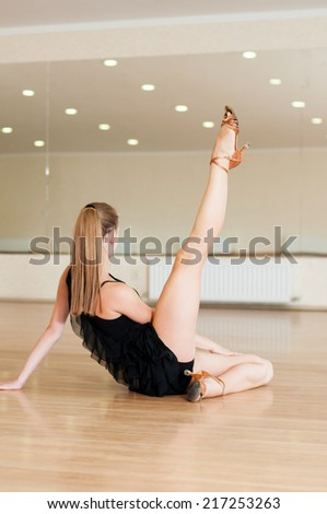 Young girl doing exercises in a dance class - stock photo