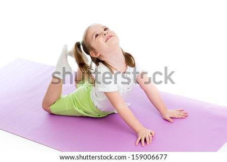 Young girl doing gymnastics - stock photo