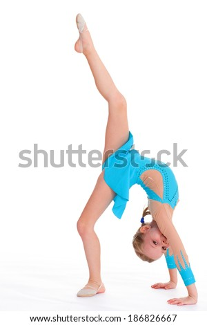 young girl doing gymnastics over white background - stock photo