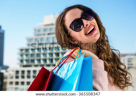 Young girl doing shopping in a sunny day - stock photo