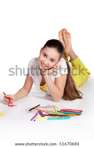 Young  girl draws a felt-tip pens - stock photo