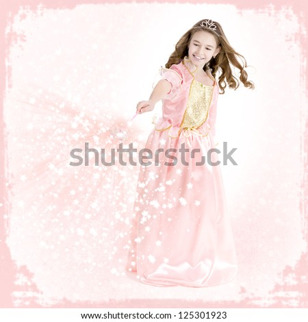 Young girl dressed as a princess with magic wand charms - stock photo