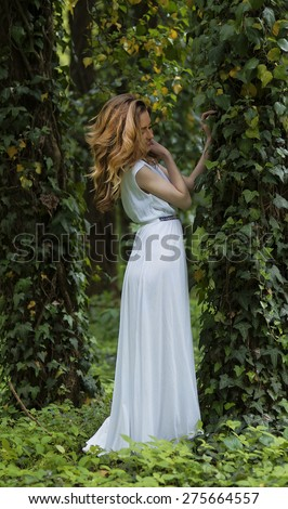 Young girl dressed in a white skirt,  in the park - stock photo