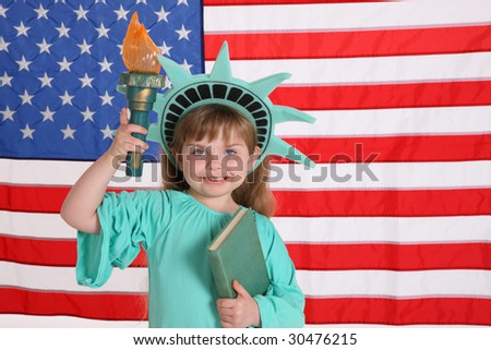Young girl dressed up like Statue of Liberty - stock photo