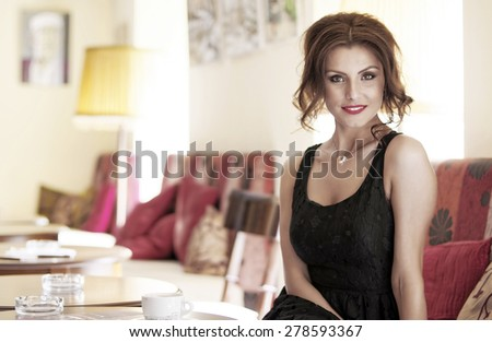 Young girl drinking coffee during the job break - stock photo