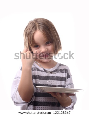 young girl eating cake with fork - stock photo