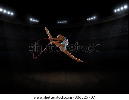 Young girl engaged art gymnastic at sports hall - stock photo