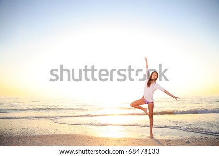 Young girl enjoys summer day at the beach. - stock photo