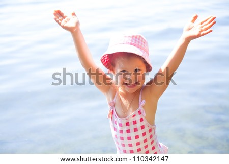 young girl enjoys the rest by the water - stock photo