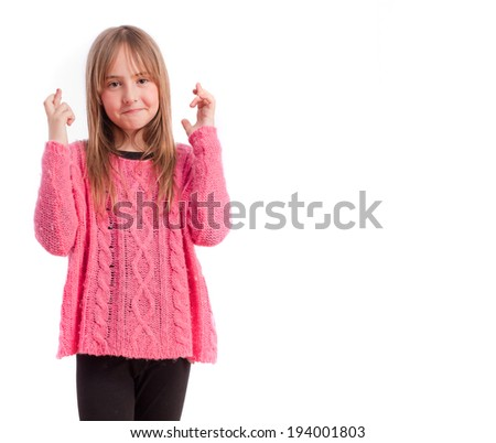 Young girl finger cross gesture - stock photo