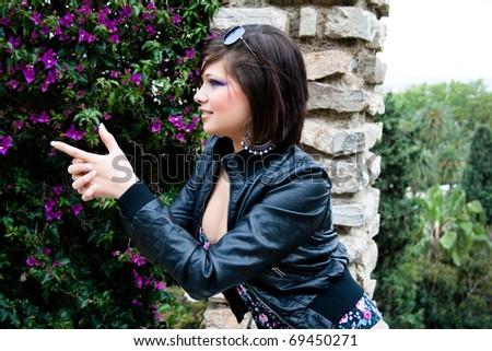 Young girl finger shooting - stock photo