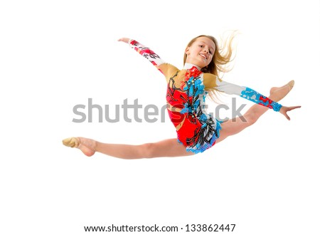 Young girl gymnast jumping - stock photo