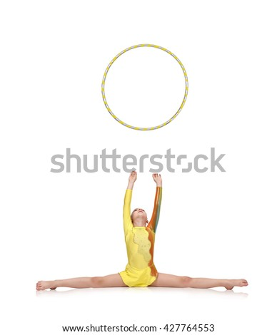 young girl-gymnast throws up hula hoop isolated on white - stock photo