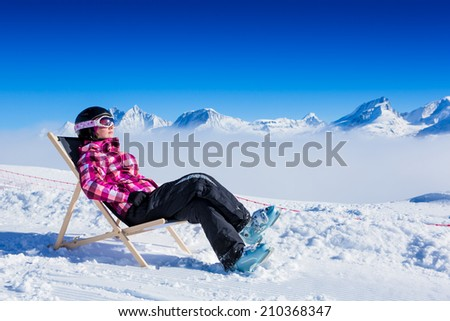 Young girl have a rest at mountains in winter. Winter ski vacation - stock photo