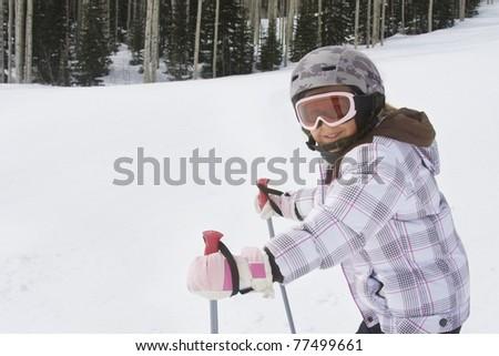 Young Girl having fun skiing at a ski resort - stock photo