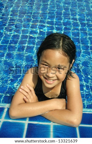 Young girl having good time in the pool. - stock photo