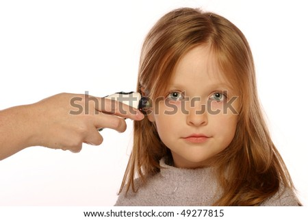 Young girl having her temperature taken - stock photo