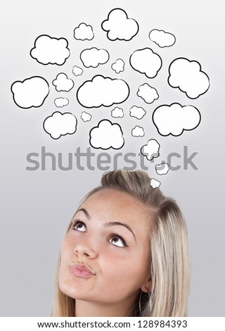 Young girl head thinking about white clouds - stock photo