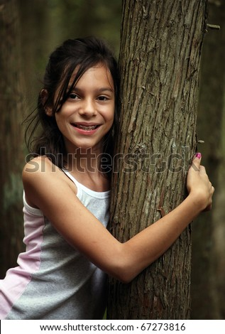 Young girl hiking in the woods - stock photo