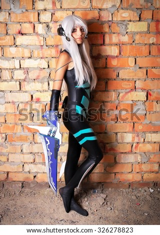 Young girl holding a blade in the dungeon Original cosplay character. Artistic shoot, new conceptual idea  - stock photo