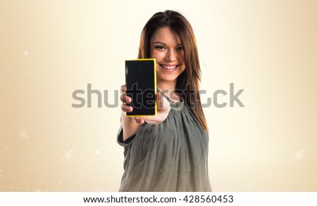 Young girl holding a mobile - stock photo