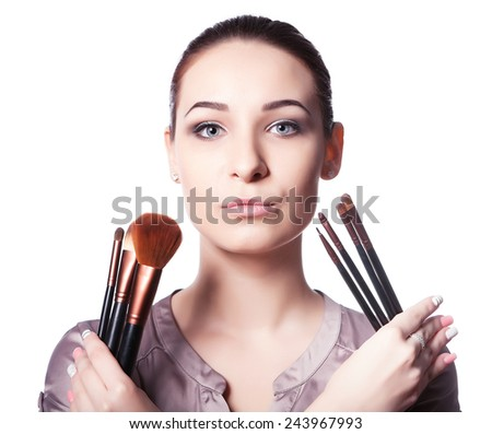 young girl holding a set of professional makeup brushes. advertising makeup - stock photo