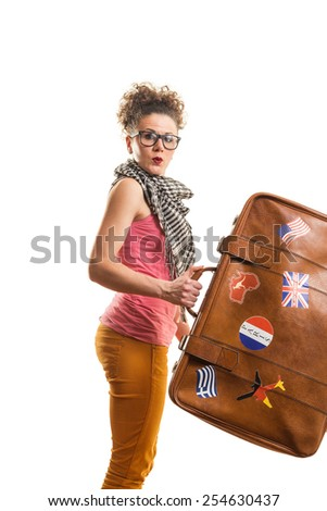 Young girl holding a suitcase studio shot - stock photo
