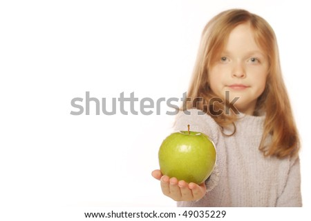 Young girl holding apple blurred for effect - stock photo