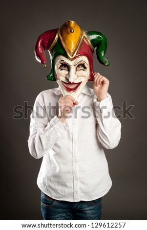 young girl holding carnival mask - stock photo