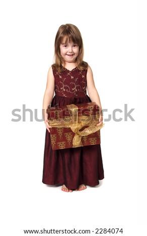 Young Girl Holding Christmas Present - stock photo