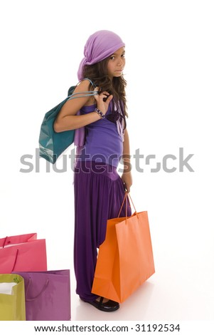Young girl holding colorful shopping bags - stock photo