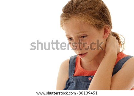 young girl holding her neck in pain - stock photo