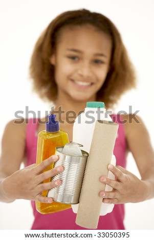 Young Girl Holding Recycling - stock photo