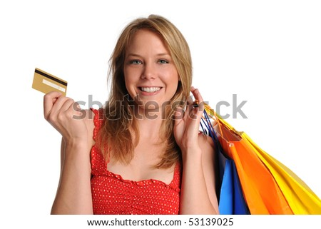 Young Girl holding shopping bags and credit card isolated on white - stock photo