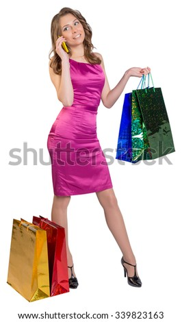 Young girl holding shopping bags and talking on the phone. - stock photo